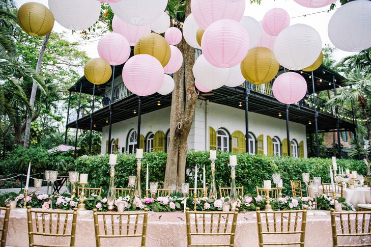 The head table was decorated with different sized ivory, pink and gold lanterns in addition to garlands, mercury glass and candles.