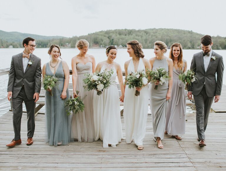 Wedding Party Walking Together On A Dock