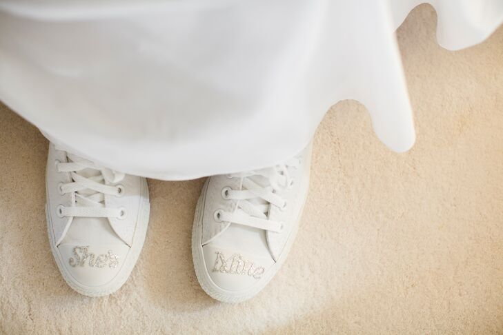 "Stephanie wore custom white sneakers with ""She's Mine"" written on the top with glitter."