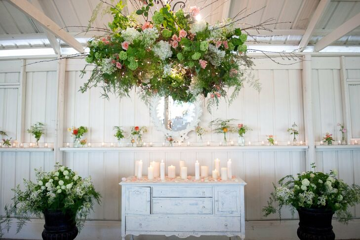 The florist and owner of Camrose Hill created a lush floral chandelier above the painted wardrobe that served as the altar.