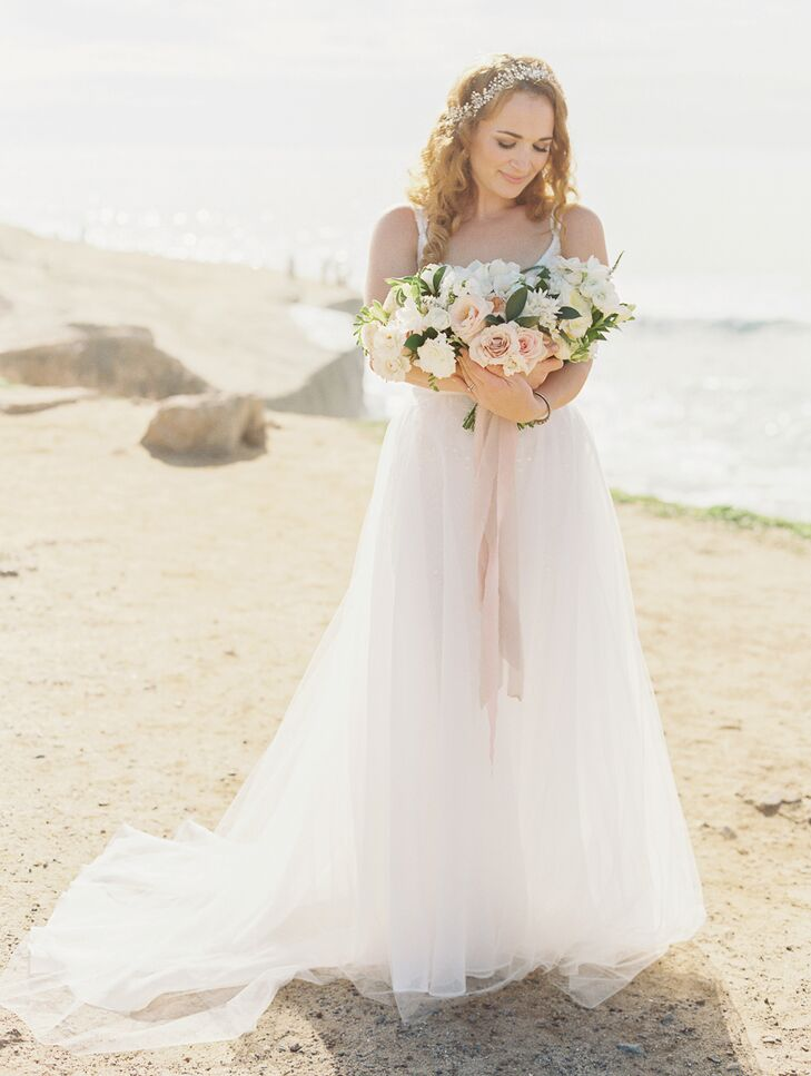 Nicky picked out an absolutely stunning dress by Anthropologie's wedding brand BHLDN, which embodied the perfect amount of elegance for the romantic occasion.  Beads embellished the gown from top to bottom, with a tulle overlay covering the skirt portion of the dress.