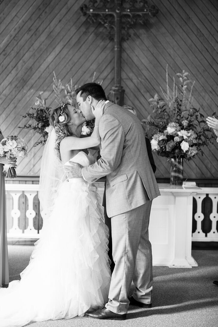 Brooke and Clayton shared their first kiss at the altar inside Old St. Hilary's church, bordered by two flower arrangements perched on top of pillars. During the ceremony, Brooke and Clayton placed letters they wrote, letters their parents wrote and a small bottle of champagne inside a box, which they planned to open on their five-year anniversary.