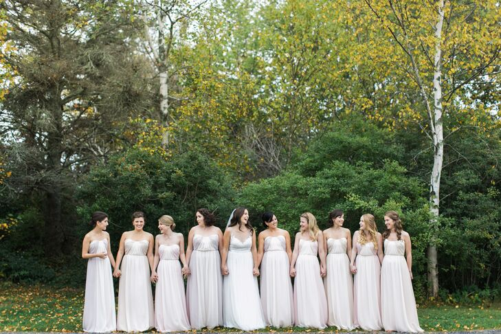 "Jenn's nine bridesmaids wore the same strapless, floor-length, sweetheart neckline Jim Hjelm dress in three different shades. ""It's a two-toned dress so the slight color change just gave each three girls an ever so slight difference that I really loved,"" she says."