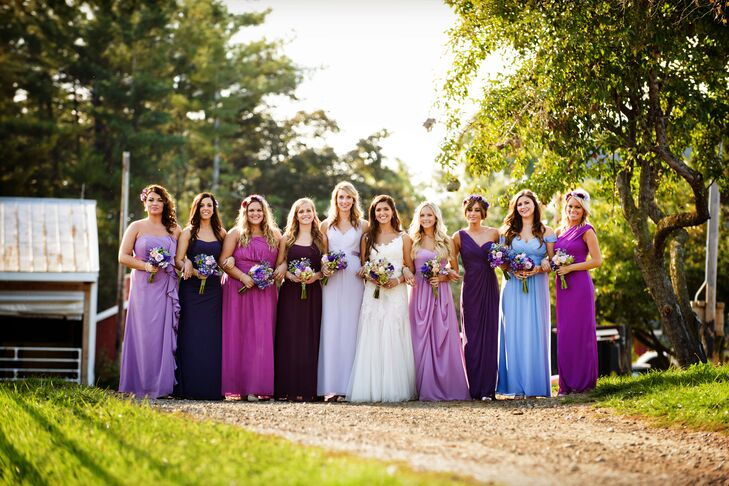 The bridesmaids dresses were floor length chiffon gowns of different styles in shades of purple.  The girls were able to pick their own dresses so they would feel comfortable in their own style choices. They carried handmade beaded clutches and wore earrings and handmade crystal bracelets.