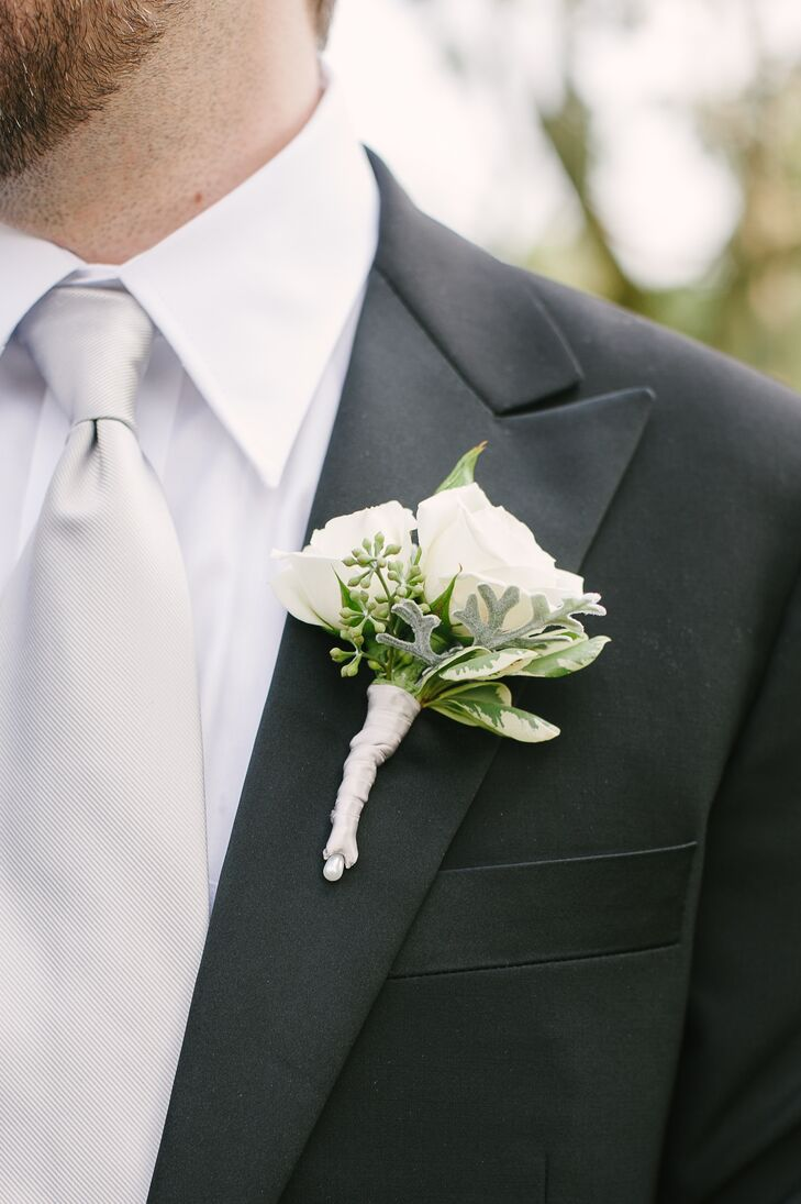 Evan wore a crisp boutonniere that had ivory roses and a mix of green leaves.