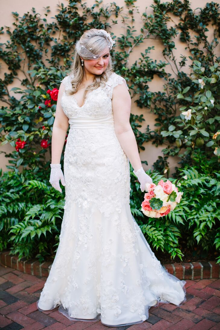 """When it came time to find the perfect dress, Jackie knew exactly where to go. """"My mom and one of her sisters bought their wedding gowns at Yvonne Lafleur in New Orleans, so it just made sense to me to go there first. And once you find the perfect dress, you don't keep looking!"""" says Jackie. She decided on a lace mermaid gown with an empire waist and lace cap sleeves."""