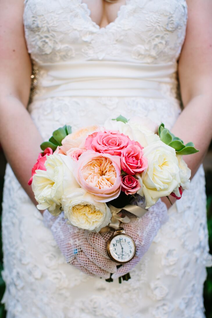 Garden and tea roses in shades of bright pink, soft peach and ivory filled Jacke's bridal bouquet. An addition of green succulents introduced a fresh textural element to the romantic arrangement.
