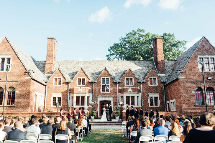 "The ceremony took place on the lawn of the Moorestown Community House in Moorestown, New Jersey. The building's stately early-20th-century facade provided a charming backdrop for the couple's ""I dos,"" while wrought-iron candelabras topped with bundles of white and burgundy blooms heightened the occasion's sense of romance."