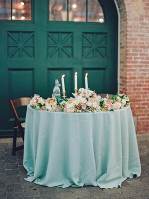 Romantic Sage Sweetheart Table With Floral Garland
