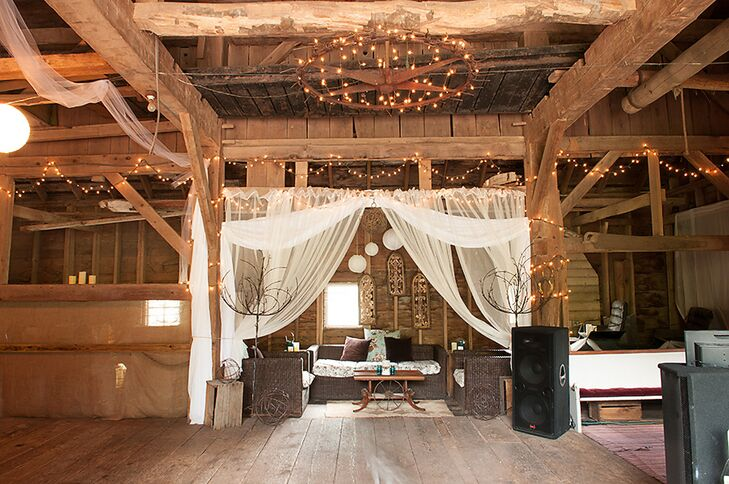String lights and white drapery added romantic and elegant elements to Mary and Sam's barn reception at Maple Shade Farm.