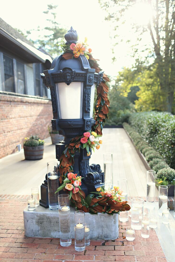 A garland of flowers and magnolia leaves wrapped around the lampposts and spilled down the front of the stairs on either side of the entrance to Deerpark on Biltmore Estate.