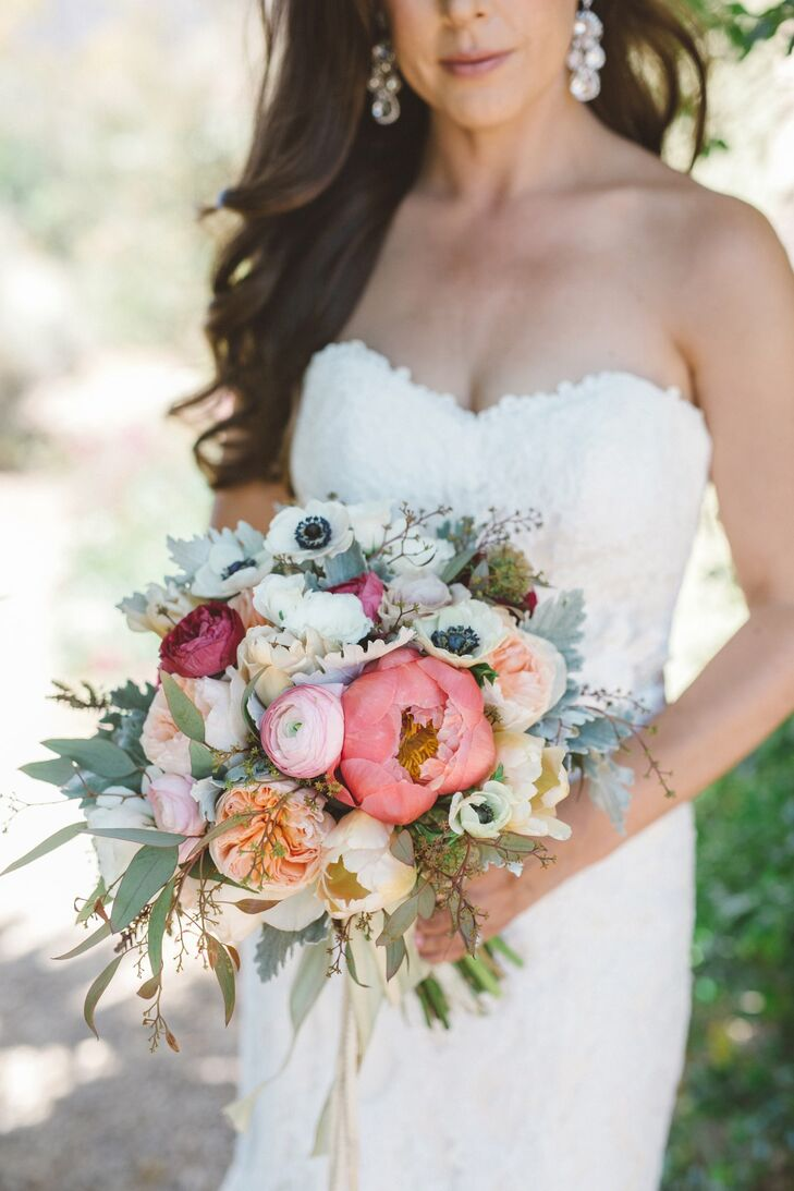 Tracy's bountiful bouquet was a loose gathering of garden roses, succulents, eucalyptus, peonies and eye-catching black-center anemones. The flowers perfectly complemented the intimate ceremony and the outdoor reception in Ojai, California.