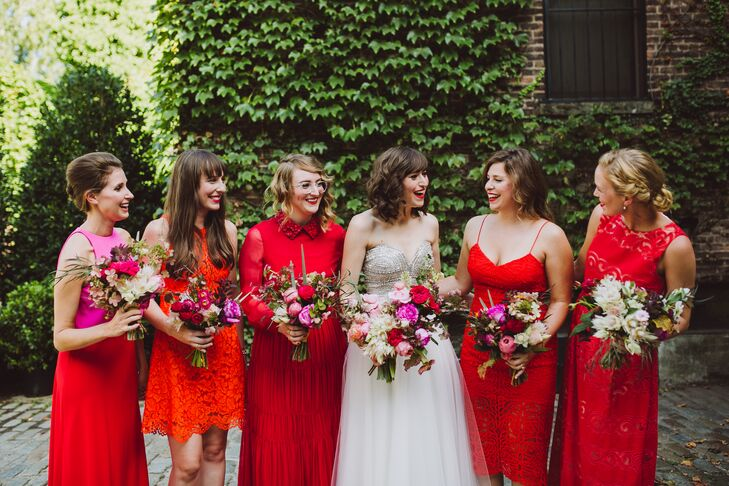 The Five Bridesmaids Popped In Bright Red Orange And Pink Dresses All Made By