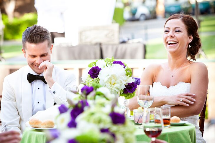 Table linens were ivory with green apple runners to add pops of color. Floral centerpieces matched the bridal party bouquets of white, purple and green flowers.