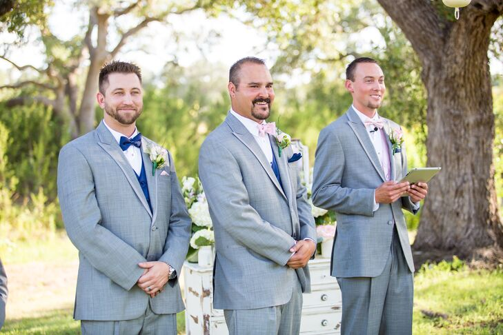 a3612e230e3b The groomsmen wore light gray suits with navy vests and navy bow ties. The  groom's