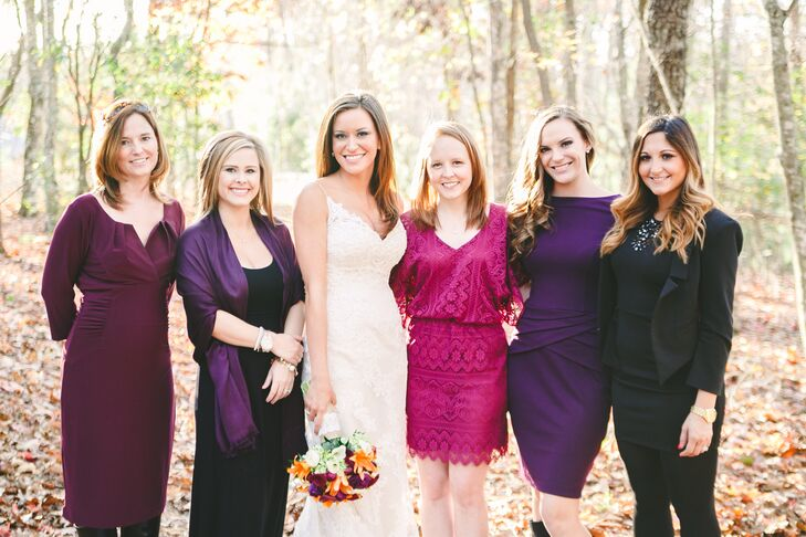 Amy's bridesmaids chose different dresses in deep jewel tones.