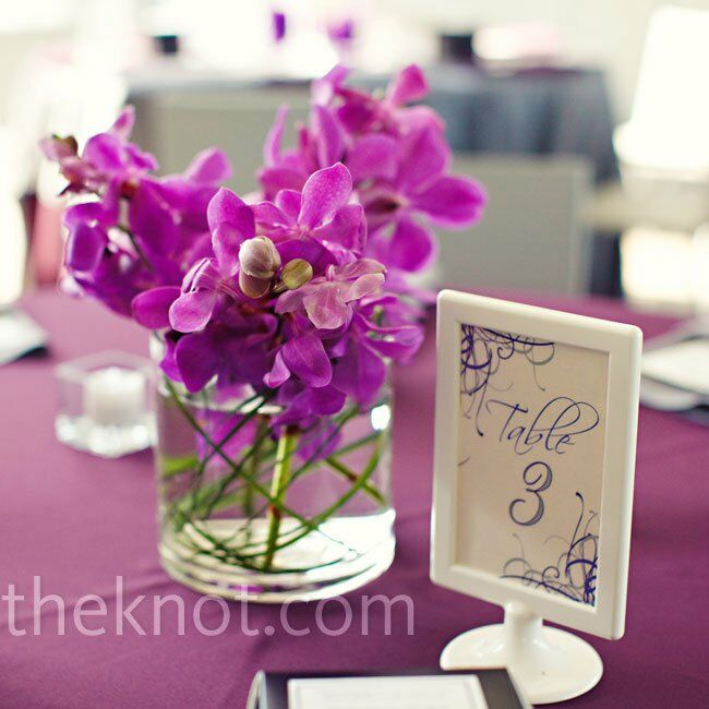Some of the dinner tables were topped with simple vases filled with orchids.