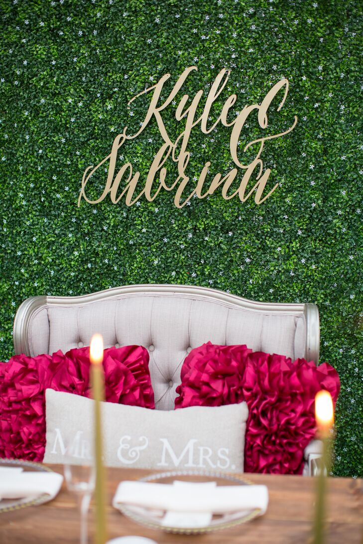 Gold Script Sweetheart Table Sign on Greenery Wall