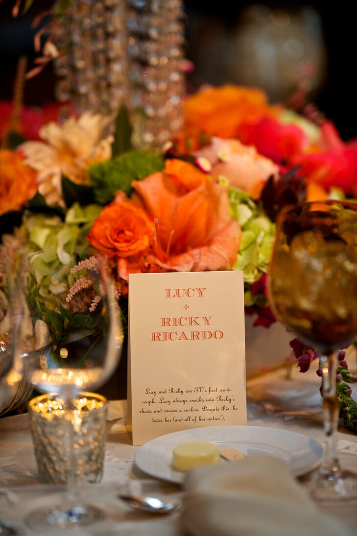 """The """"table numbers,"""" made by Magnificent Milestones, were named after famous couples, including Marie and Pierre Curie, Jim and Pam from """"The Office,"""" Guinevere and Lancelot and Lucy and Ricky Ricardo. Each card was tented on the corresponding table with a description of the couple."""