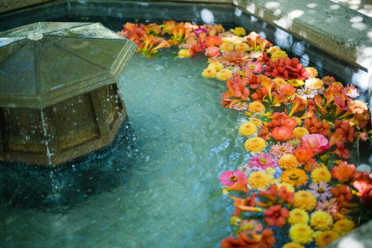 The couple filled the elegant stone fountain with vibrantly colored blooms.