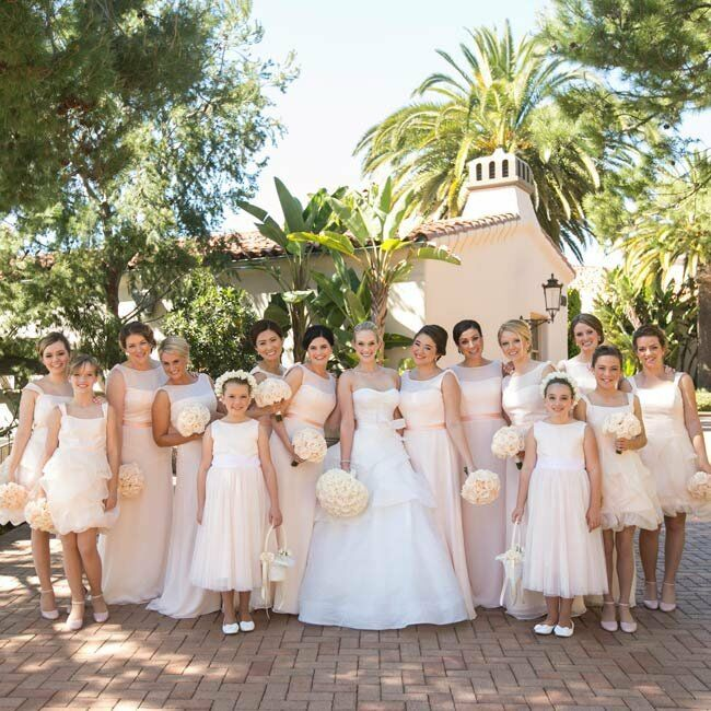 The junior bridesmaids wore short white dresses with ruffled skirts that stood out from the sea of blush gowns.