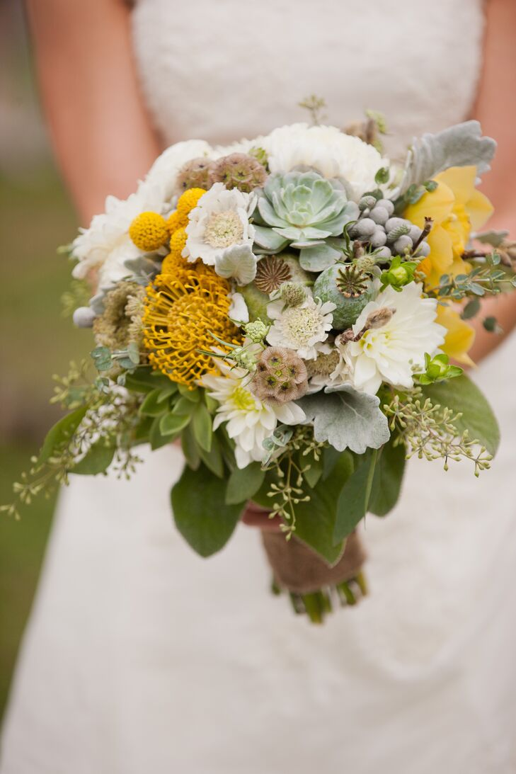 Sandra carried an organic-style bouquet of pincushion proteas, succulents, scabiosas and white dahlias.