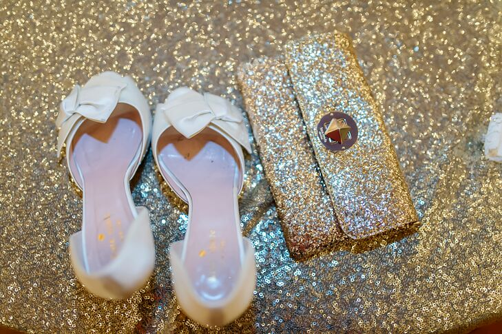 Caroline wore ivory satin gold glitter kitten Kate Spade heels with her wedding dress. She was also given a matching gold glitter Kate Spade clutch to match by her mother.