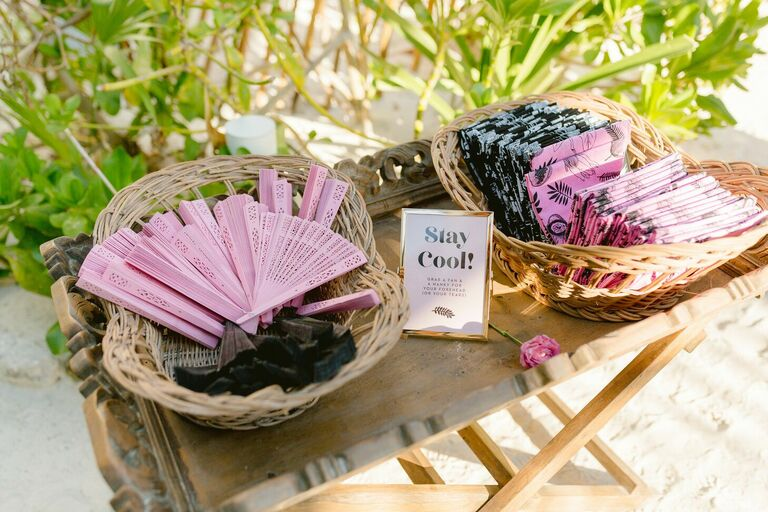 Pink and black fans and handkerchiefs for beach wedding guests