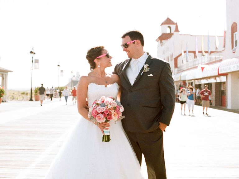 New Jersey wedding couple posing on boardwalk in sunglasses