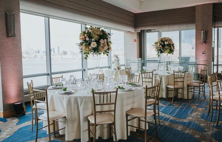 Classic Ballroom Reception with Ivory Linens and Gold Chiavari Chairs