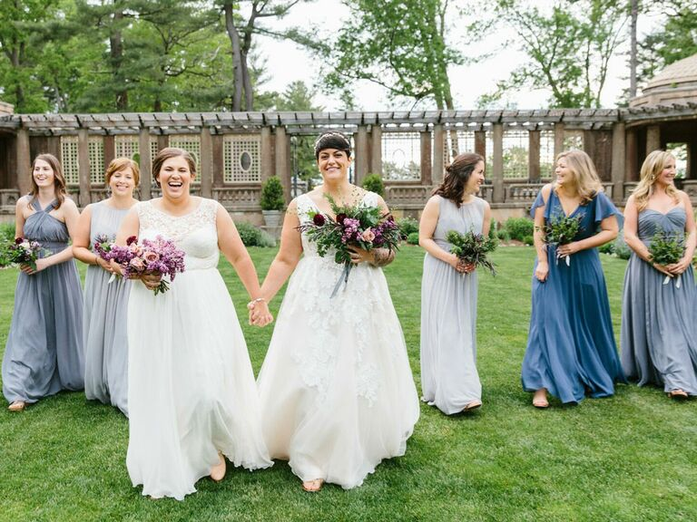 Brides walking to ceremony with bridesmaids