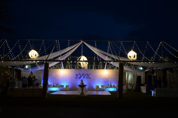 The reception took place in a romantic tented area outside of the Pedro St. James Castle on the island of Grand Cayman.