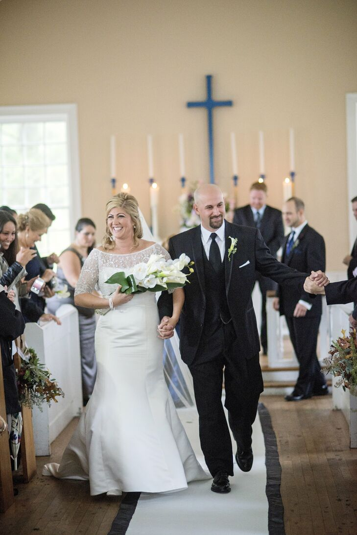 The bride wore a strapless satin Oleg Cassini mermaid gown with a beaded pop-over jacket.