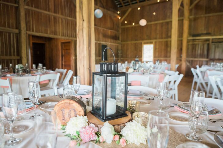 Derek's father hand-cut each wooden slice centerpiece himself, which were later topped with simple lanterns and surrounded by votives.