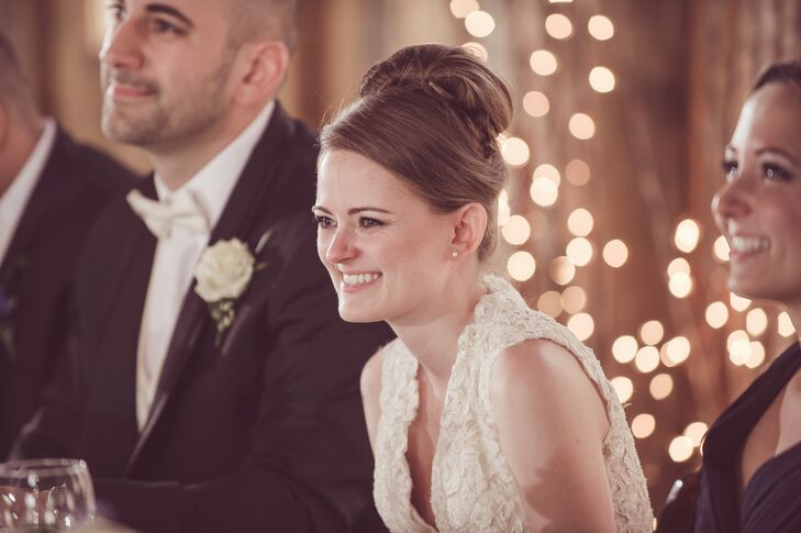The bride wore her hair in a simple, yet classic, updo style created by Riah Salon.
