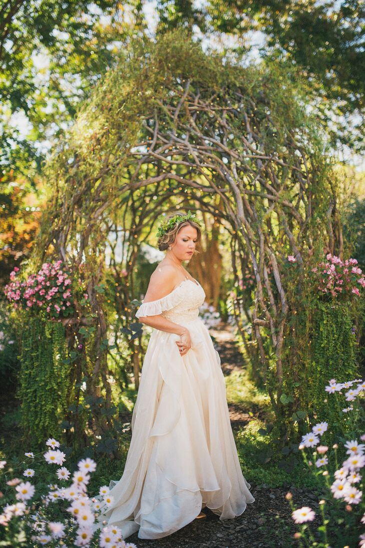 Comfort was key for the bride, who wore rose gold Toms under her dress. She had sleeves added to the design, and her gown flowed when she walked. She accessorized with a rose gold necklace and bangle with crystal drop earrings.