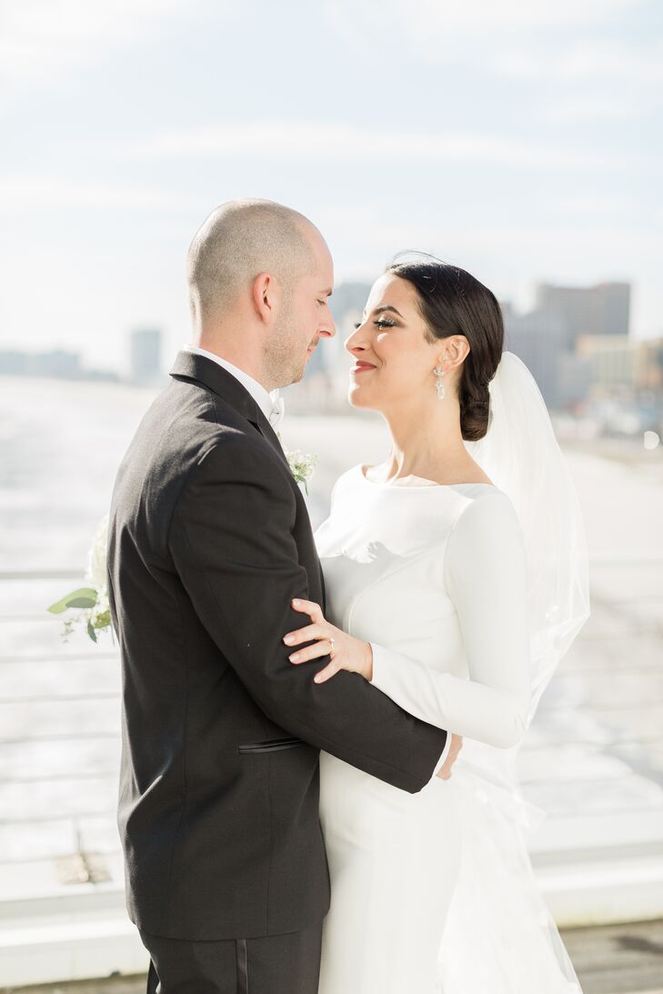 Bride in Long-Sleeve White Dress with Veil