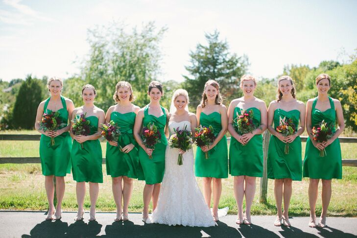 Allison's eight bridesmaids wore knee-length, shamrock-green dresses by Dessy. I was very particular about the color of the bridesmaids' dresses, says Allison. I wanted a rich, vibrant emerald green to complement my bright flowers.