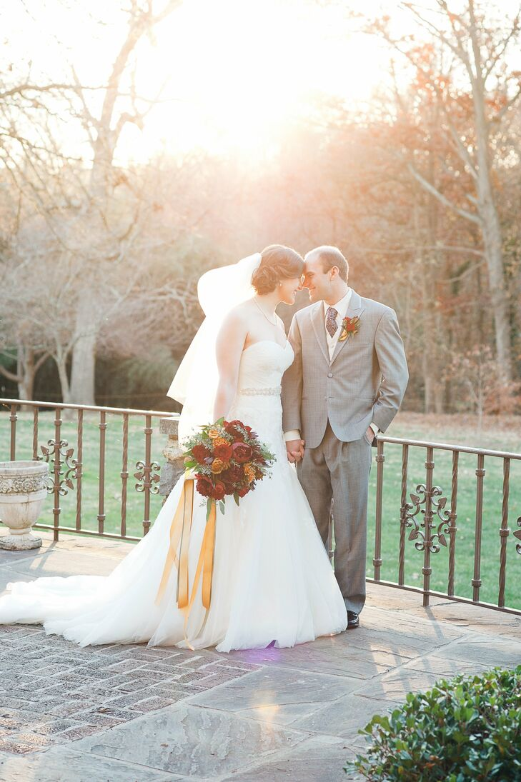 A rich color palette of burgundy, burnt orange and gold paired with warm candlelight and lush floral arrangements gave the Graylan Estate, where Ellie