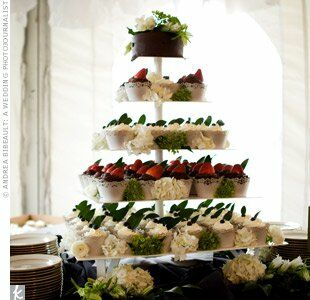 Guests drooled over this tower of chocolate and French vanilla cupcakes topped with buttercream frosting, fresh berries, and mint leaves. The couple also offered an ice cream sundae bar and homemade chocolate chip cookies, which Tara and her mom had baked that morning.