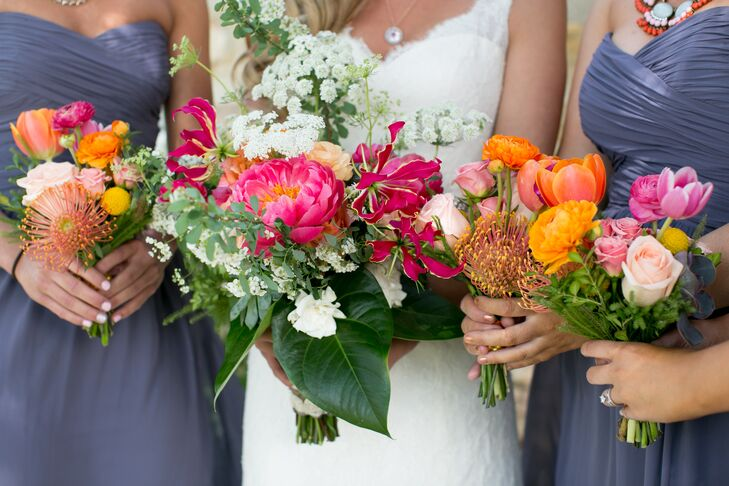 Megan carried pink peonies, pink orchids, white Queen Anne's lace and plenty of greenery in her lush bouquet. After meeting her florist, Daydream Design, several times at the Lawrence, Kansas, farmers' market, and knowing that she understood her wedding style, she gave her free rein to create all the florals.