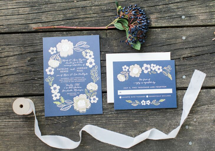 The bride and groom designed the stationary together through minted.com.  They used the same color scheme and floral design they included in their wedding decor.  The color palette for the wedding was navy, blush and gold.