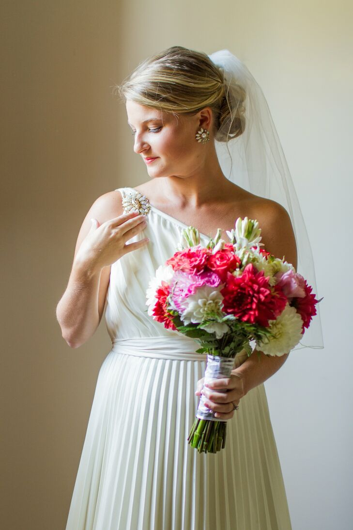 The bride accessorized with a medium-length veil and family heirloom jewelry.