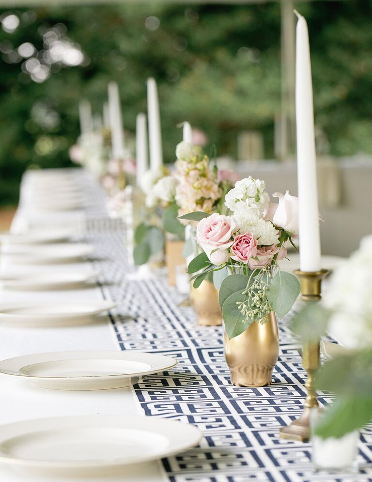 White and blue patterned table runner with tall taper candles
