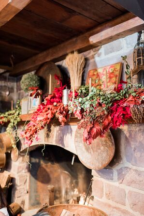 Rustic Fireplace with Hanging Autumn Leaves