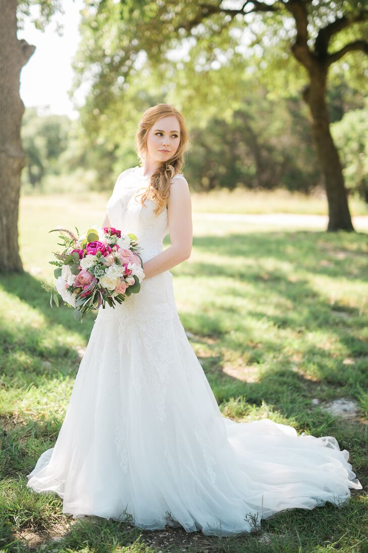 """""""I knew from the beginning that I wanted a lace wedding dress,"""" Brieann says. """"The rest was kind of up in the air."""" She tried on a number of styles before falling for a high neckline and open back, fitted enough to flatter her figure yet full enough at the bottom to make her feel like a princess."""