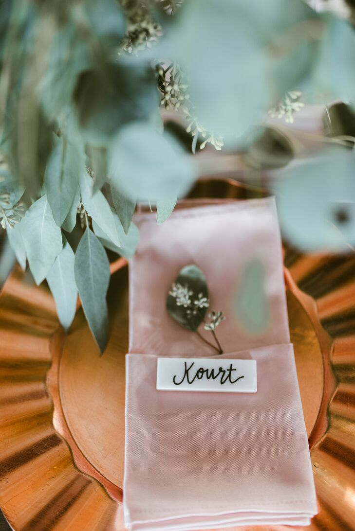 Place settings were simple but still chic, with rose-gold chargers, blush-pink napkins and calligraphed name tags.
