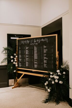 Black-and-White Chalkboard Seating Chart with Flower Arrangements