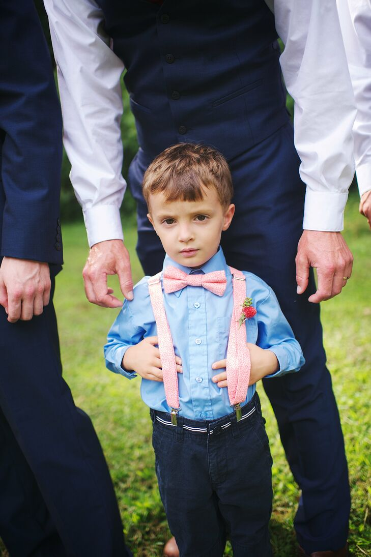 The ring bearer looked adorable in a peach bow tie and suspenders that matched the wedding's color scheme.