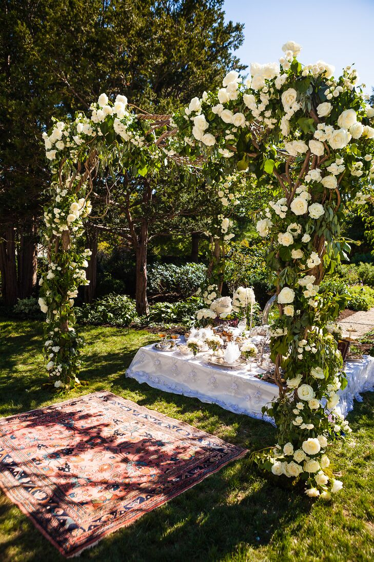 "Simin and Nicholas thoughtfully paid tribute to their Persian and Jewish backgrounds throughout the ceremony by sharing customs and decor. For all three portions of the ceremony, the couple stood under a beautifully ornate vine chuppah draped in lush bundles of ivory and blush roses. ""During the ceremony, Nicholas's father read a Jewish blessing, and four friends and family members of his held the poles of the chuppah, symbolizing the importance of family and friendship in building, supporting and strengthening our home,"" Simin says."